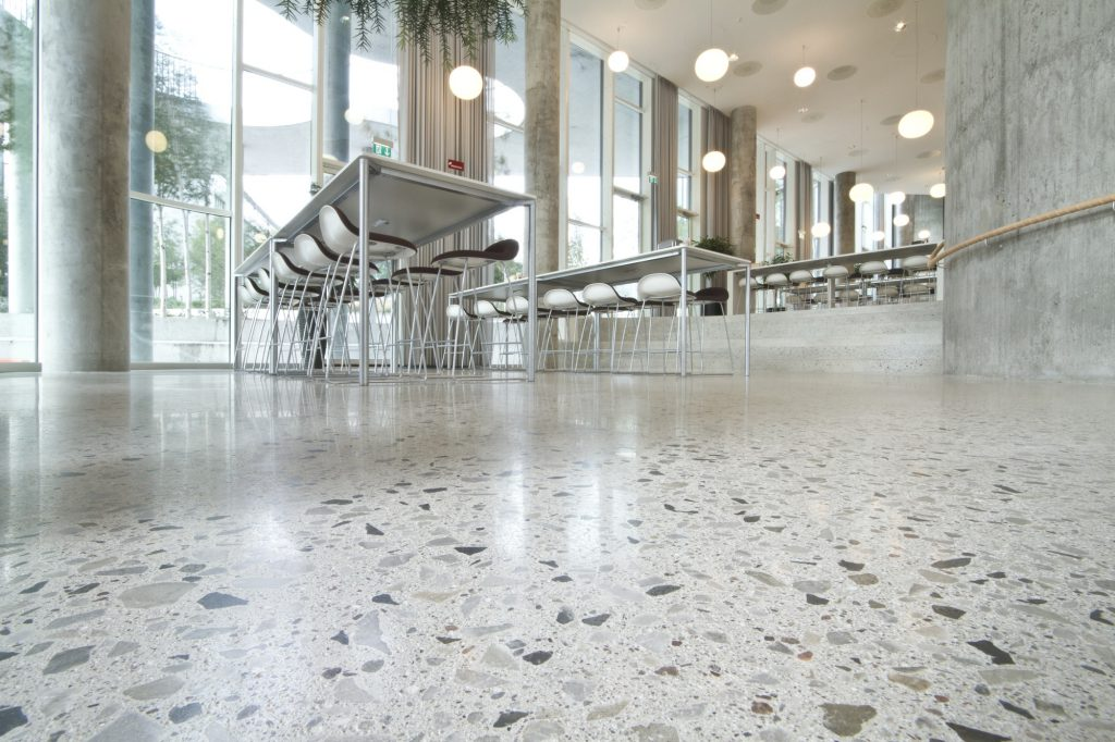 Polished concrete vs resin floors all things flooring for Commercial bar flooring